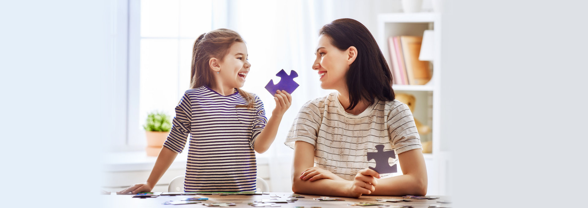 woman and child playing puzzle